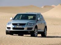 Тюнинг обвес на VW Touareg I : накладка на передний и задний бампер, пороги, спойлер на багажник